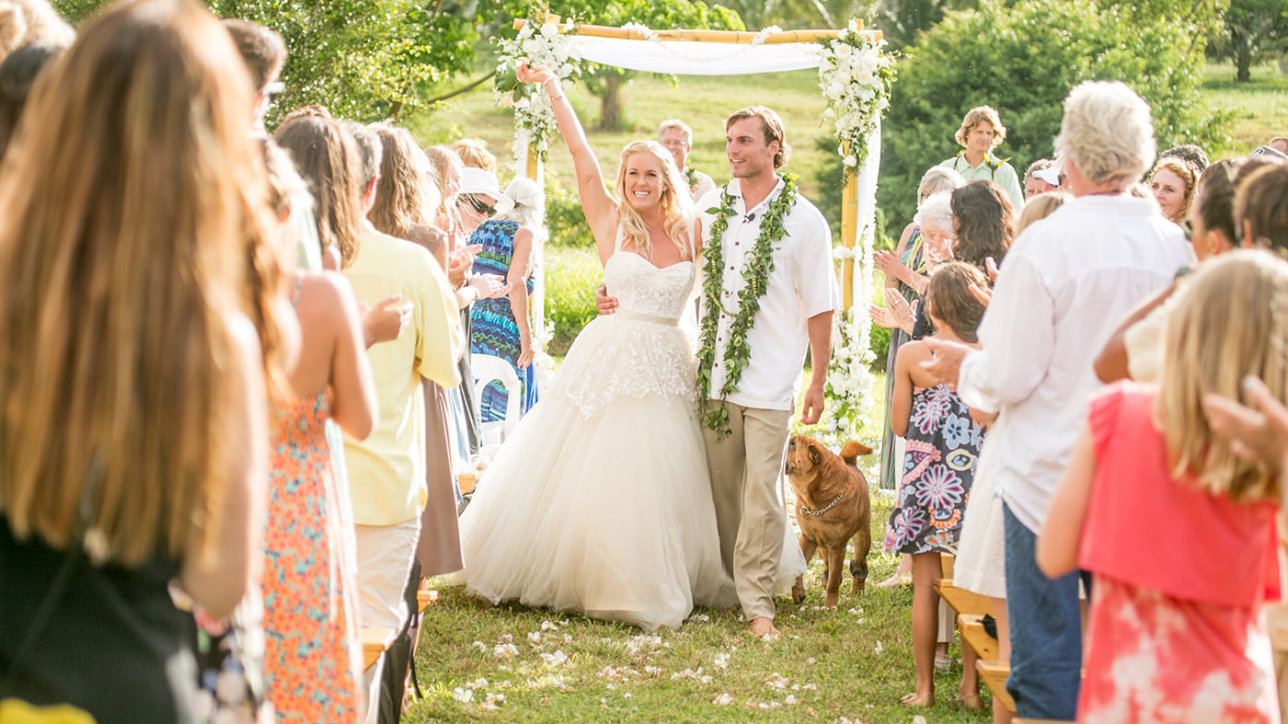 a joyous moment, Bethany's dog Hana follows the happy couple down the aisle.