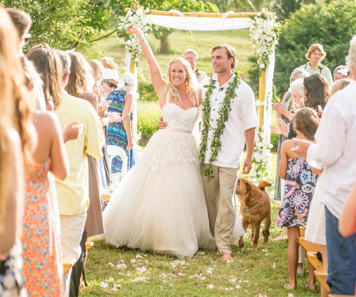 a joyous moment, Bethany's dog Hana follows the happy couple down the aisle.